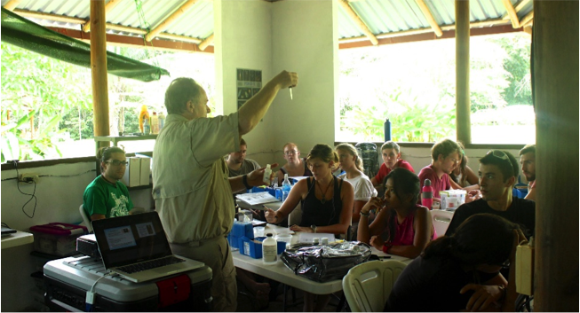 Jim demonstrating how to conduct a dissolved oxygen test. Photo by, Anahí Quiñones