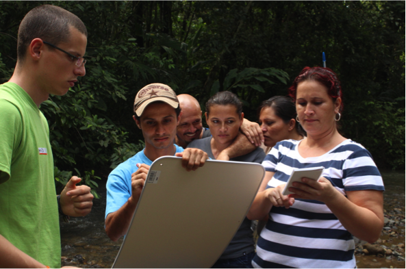 David supervising data entry by community members. Photo by, Erin Engbeck