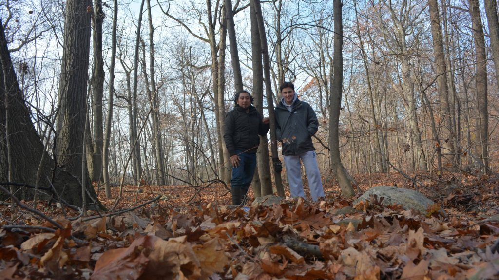 Juan Carlos and Jeremy pose in front of a camera trap.